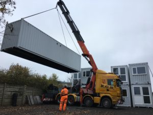 Craning ISO Spaces social housing containers into Procar Stanwell HQ yard for short term storage