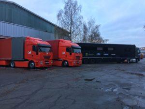 Philip Morris Ferrari F1 Hospitality trucks alongside Hoonigan WRX Hospitality truck